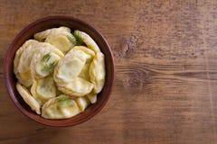 Gnocchi, riempiti di formaggio dell'agricoltore della ricotta Varenyky, vareniki, pierogi, pyrohy Fotografia Stock