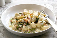 Gnocchi with Smoked Salmon and Peas Royalty Free Stock Images