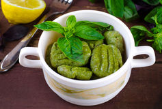 Gnocchi with spinach, basil and lemon Stock Photo