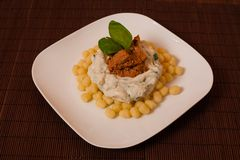 Gnocchi and spinach. Royalty Free Stock Image