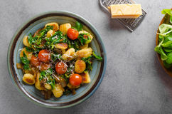 Gnocchi with spinach, garlic and tomatoes Stock Photography