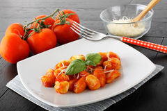 Gnocchi with tomato sauce and basil Stock Images