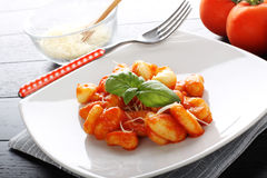 Gnocchi with tomato sauce and basil Stock Image
