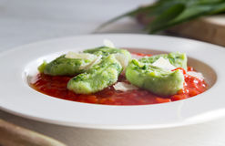 Gnocchi with wild garlic in tomato sauce and parmesan cheese Royalty Free Stock Image