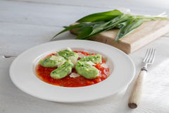 Gnocchi with wild garlic in tomato sauce and parmesan cheese Stock Image