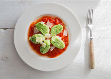 Gnocchi with wild garlic in tomato sauce and parmesan cheese Stock Photo