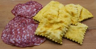 Gnocco fritto or Crescentine with slices of salami, traditional italian food from Modena or Bologna, Italy stock photography