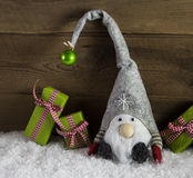 Gnom santa with green and red christmas presents in rustic count Stock Images