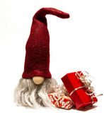 Gnome and christmas gifts. Christmas gnome with pile of christmas gifts Royalty Free Stock Photos