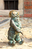 Gnome Gangster. Close up of a metal gangster dwarf with a gun and cap in the main square of Wroclaw, Poland stock images