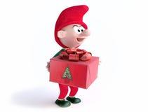 Gnome drôle avec le cadre de cadeau de Noël Photo stock