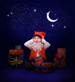 Gnome with gifts at the New Year midnight Stock Images