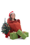 Gnome girl sitting in bag with presents Stock Images