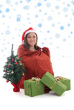 Gnome girl sitting in bag with presents Royalty Free Stock Images