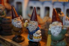 Christmas market in Cologne with gnomes. A gnome at his favorite activity Royalty Free Stock Photo