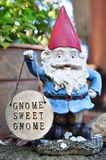 Gnome. Nature garden home object decoration outdoor yard sweet red hat blue shirt gnome sunny phillips green tree plant Stock Photo