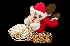 The gnome protecting gold with pearls Royalty Free Stock Photography