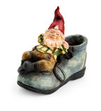 Gnome sitting on a boot. Stock Photography