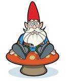 Gnome sitting on mushroom Stock Photo
