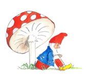 Gnome sitting under mushroom Stock Photo