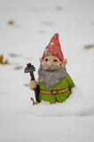 Gnome in the snow. Photograph of a garden gnome in the snow Royalty Free Stock Image