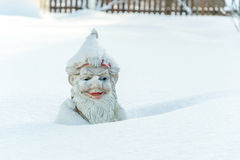 Gnome in snow Royalty Free Stock Photo