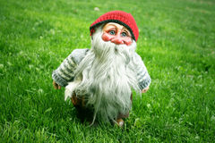 Gnome standing on the grass Stock Images