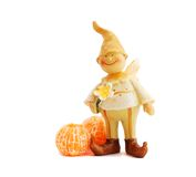 Gnome and tangerine Stock Image
