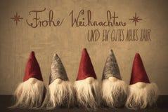 Gnomen, Kalligraphie Frohe Weihnachten bedeutet frohe Weihnachten Stockbilder