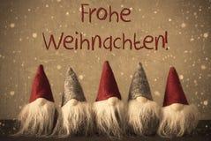 Gnomen, Schneeflocken, Frohe Weihnachten bedeutet frohe Weihnachten Lizenzfreie Stockfotos