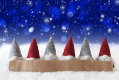 Gnomes, Blue Background, Bokeh, Stars, Snowflakes, Copy Space Royalty Free Stock Photography