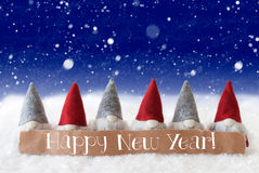 Gnomes, Blue Background, Snowflakes, Text Happy New Year Royalty Free Stock Photos