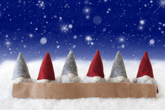 Gnomes, Blue Background, Stars, Snowflakes, Copy Space Royalty Free Stock Image