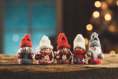 Gnomes family on wooden table Stock Photography