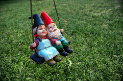Gnomes - female in front. Couple of Pesky Garden Gnomes Stock Image