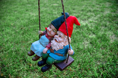 Gnomes - Male in front. Couple of Pesky Garden Gnomes Stock Photography