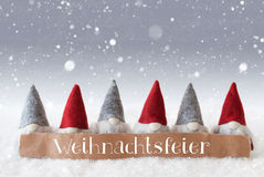 Gnomes, Silver Background, Snowflakes, Weihnachtsfeier Means Christmas Party. Label With German Text Weihnachtsfeier Means Christmas Party. Christmas Greeting stock photos
