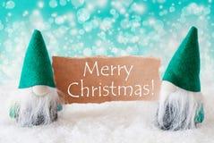 Gnomos com cartão, Feliz Natal de turquesa fotos de stock