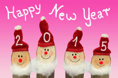 Gnomos de la Feliz Año Nuevo 2015 - cuatro con la cara sonriente Imagen de archivo libre de regalías