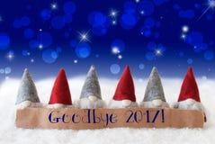 Gnomos, fondo azul, Bokeh, estrellas, texto adiós 2017 Fotografía de archivo libre de regalías
