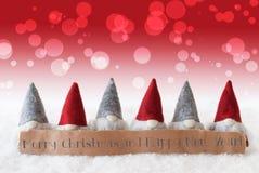 Gnomos, fundo vermelho, Bokeh, Feliz Natal e ano novo feliz Imagens de Stock Royalty Free