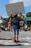 Go #1 Daddy. Little boy cheering on daddy  by holding a sign during an ironman event Stock Image