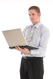 On the go. Businessman working on the laptop over white backdrop Stock Photography