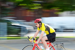 On the Go. Image of a cyclist riding his bike Royalty Free Stock Photography