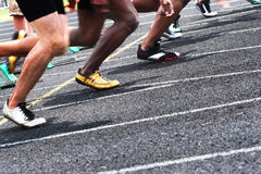 Go. Close up of a track with runners starting a race Stock Photos