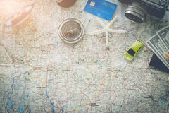 Go on an adventure! The map and the camera on a wooden table. Royalty Free Stock Image