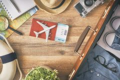 Go on an adventure. ! The map, suitcase, passports, tickets and the camera on a wooden table. Top view Royalty Free Stock Photography