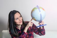Go on an adventure. Woman dreaming about traveling around the world, looking at the globe in room of the house. Pretty girl study. Go on an adventure. Woman Royalty Free Stock Photo