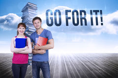 Go for it! against stack of books against sky Stock Images