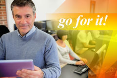 Go for it! against teacher holding a tablet pc Stock Photography